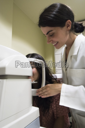 ophthalmologist placing the head of a