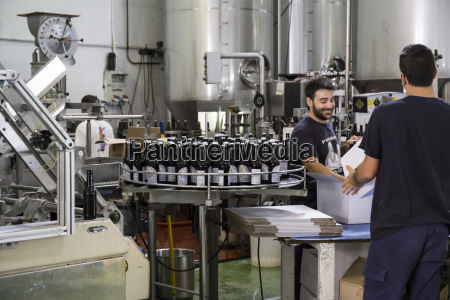 men working in beer bottling plant