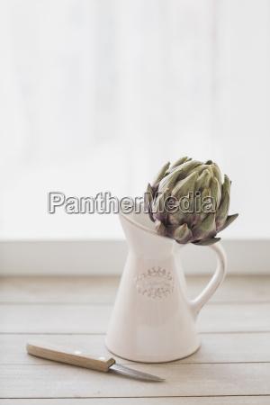 artichoke in jug kitchen knife