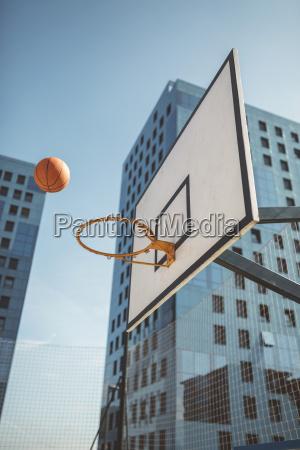 basketball flying towards hoop