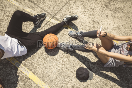 young couple sitting on ground with