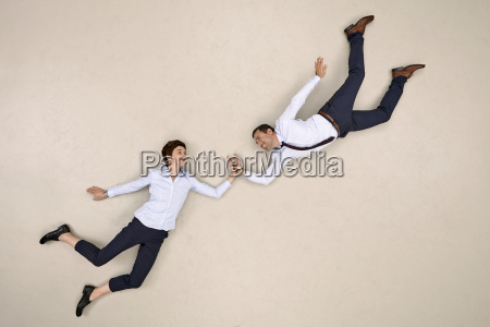 two bussiness colleagues flying and high