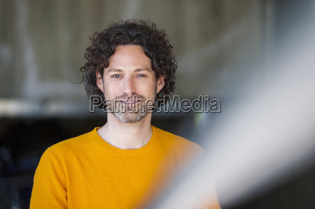 portrait of smiling man with curly
