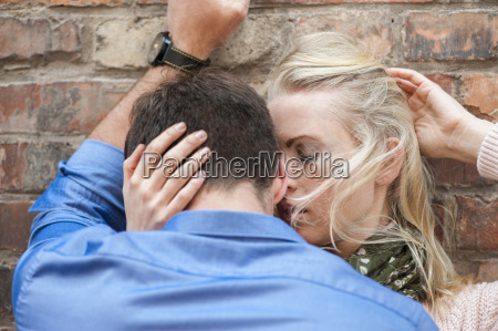 sensual couple in love leaning against