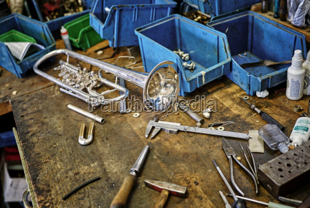 workbench of an instrument maker with