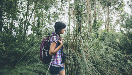 smiling young woman with backpack