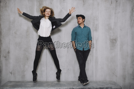 couple in front of concrete wall
