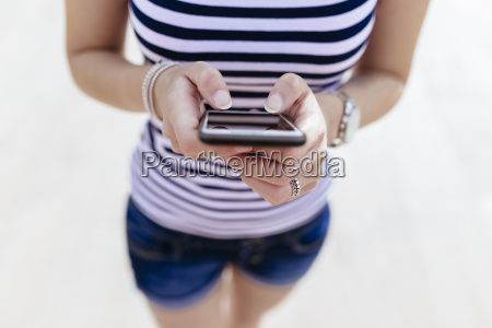 hands of woman text messaging