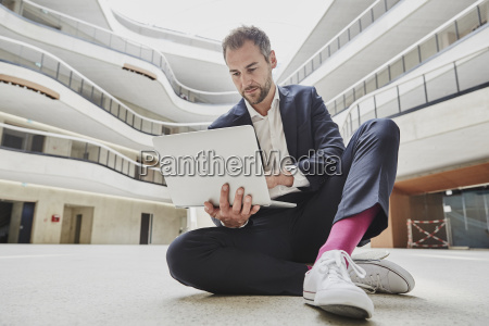 businesssman sitting on floor in office