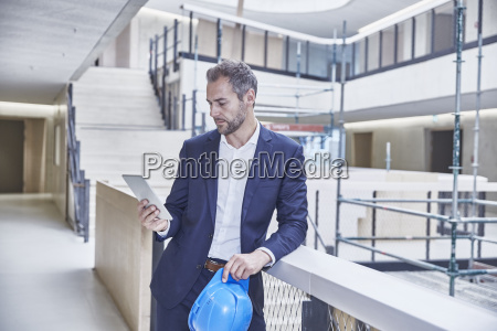 architect in office building looking at