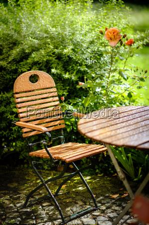 garden table and chair summer rain
