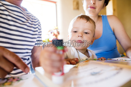 family tinkering at kitchen table
