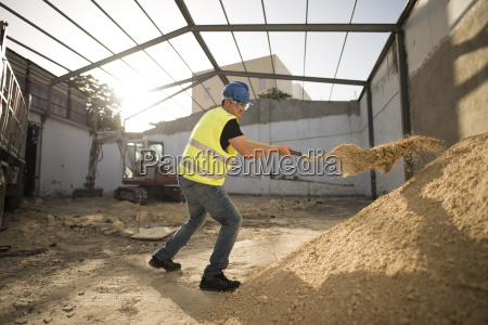 construction worker working with shovel