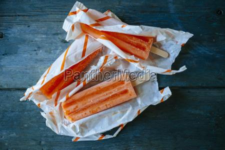 orange snow ice cream in wrappings