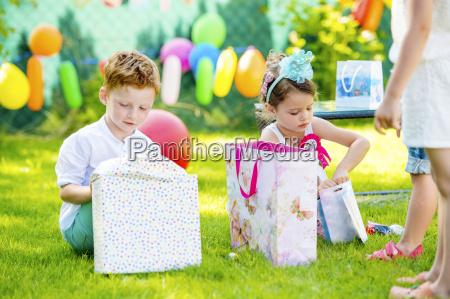 little boy and girl unpacking birthday