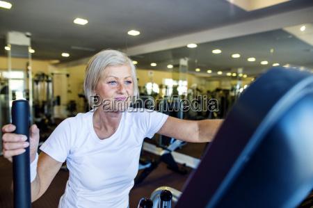 mature woman exercising on step machine
