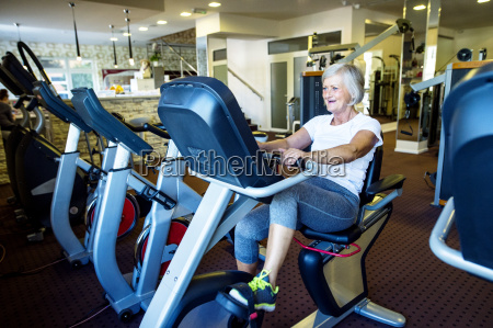 mature woman working out in fitness