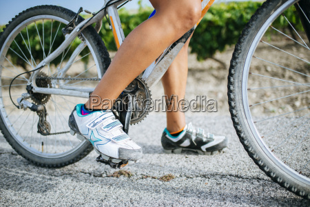 close up legs of female cyclist