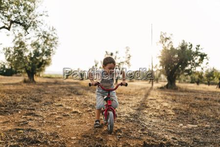 little boy with childrens bike on