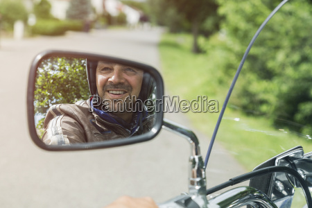 reflection of smiling man in mirror