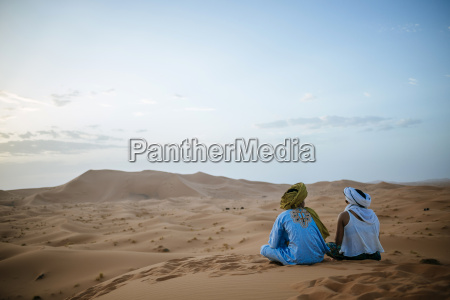 woman sitting in the desert with