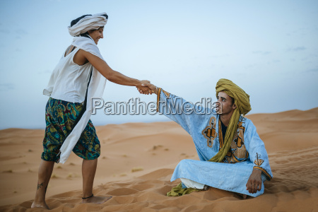 woman helping her berber guide to