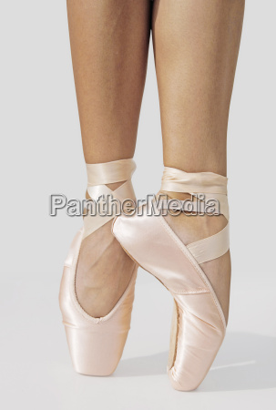 ballerina standing on tiptoes partial view