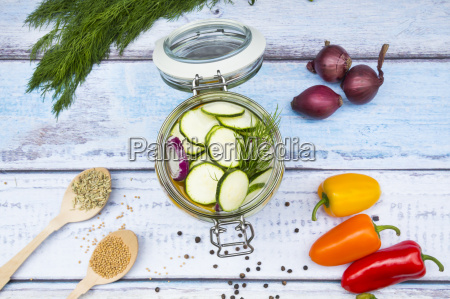 glass of pickled courgette and bell
