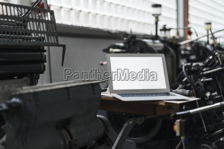 laptop in printing shop