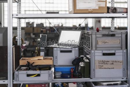 laptop on shelf in storeroom
