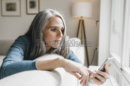 woman sitting on the couch looking