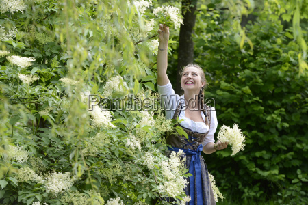 germany bavaria smiling woman wearing dirndl