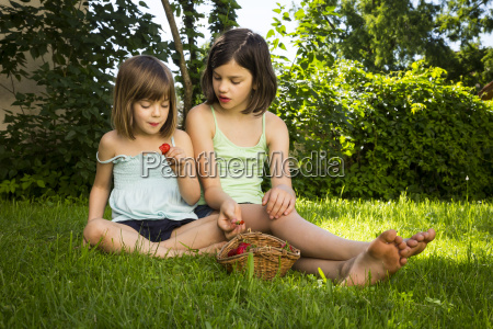 two sisters sitting together on a