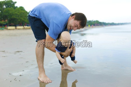 indonesia bali young father and baby