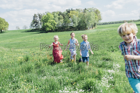 happy children running and playing in