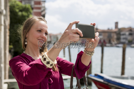 italy venice tourist taking pictures with