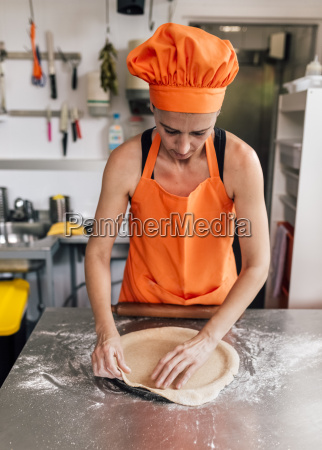 pizza baker preparing dough