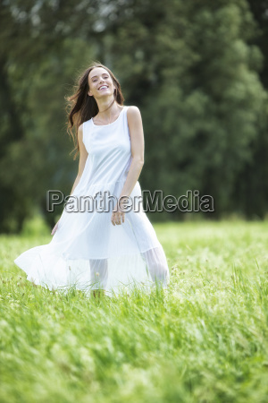 happy woman wearing white summer dress