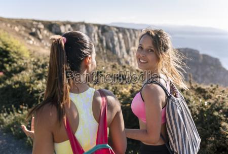 spain asturias two sportswomen talking on