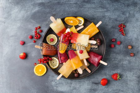 fruits and different homemade ice lollies