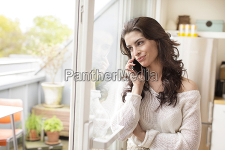 smiling young woman on cell phone