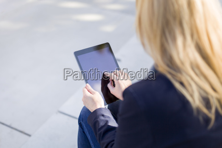 hand of businesswoman touching display of