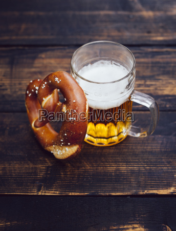 pretzel and glass of beer on