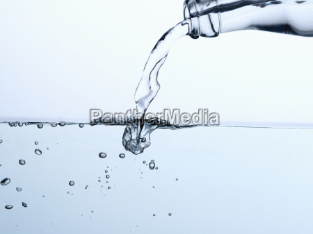mineral water pouring from bottle