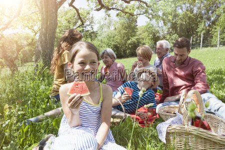 girl with watermelon at a family