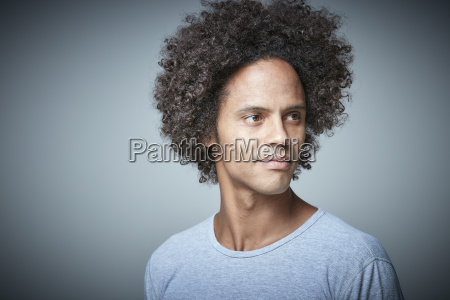 portrait of relaxed man with afro