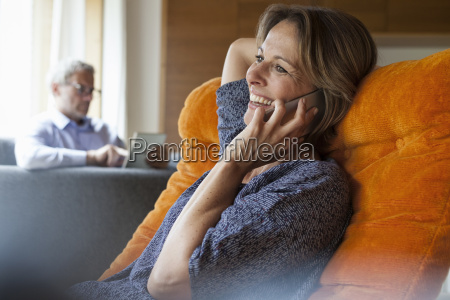smiling woman at home on cell
