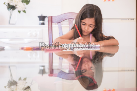 young girl on the table