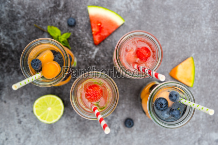 carafes of miscellaneous fruit infused water