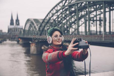 germany cologne woman taking selfie in